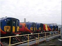 TQ2572 : Sidings and trains, Wimbledon traincare depot by David Anstiss