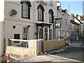 SX9372 : Flood wall and flood gate at the New Quay Inn by Robin Stott