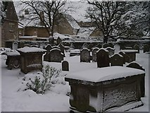 ST8992 : St Mary's graveyard Tetbury with snow by Paul Best