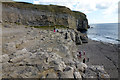 SY9976 : Children climbing at Dancing Ledge by Phil Champion