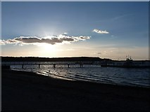 SZ1891 : Hengistbury Head: the ferry jetty against the sun by Chris Downer