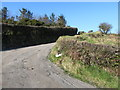 J1523 : Bends on the upland section of Carrick Road by Eric Jones