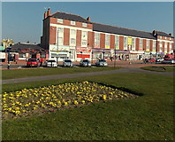 ST1166 : Flower bed and shops, Barry Island by Jaggery