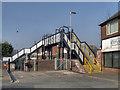 SJ4991 : Footbridge at Rainhill Station by David Dixon