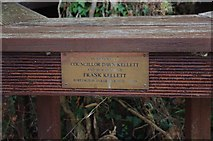 SO8090 : Memorial plaque on bench seat in car park of Holy Cross Church, Bobbington by P L Chadwick