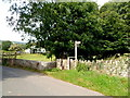 SO1022 : Wooden signpost alongside a bridge over Cwm Cwy near Talybont-on-Usk by Jaggery