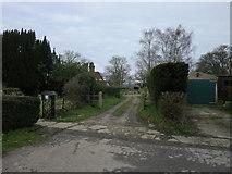TQ1328 : Farm entrance by The Saunterer