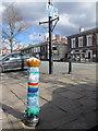 SJ5177 : A crocheted bollard cover in Main Street, Frodsham by John S Turner