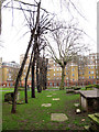 TQ3082 : Trees and ledger stones, St Andrew's Gardens by Stephen Craven