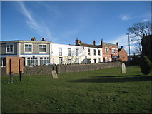 ST3049 : The churchyard and houses in Victoria Street, Burnham on Sea by Jonathan Thacker