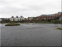 J3731 : The weir at Castle Island Park boating lake on a stormy day by Eric Jones