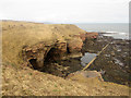 NU0054 : Caves in the cliff face of Burgess Cove by Graham Robson