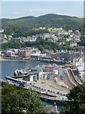 NM8529 : Oban: the station and ferry terminal from Pulpit Hill by Chris Downer