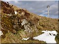 NS3679 : Exposed rock face in old quarry pit by Lairich Rig