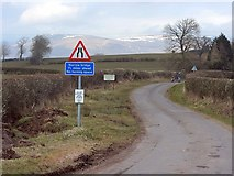 NY7213 : Minor road at Bleatarn by Andrew Curtis