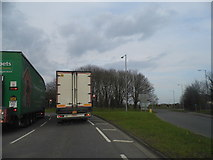 TQ7357 : The A20 approaching the roundabout for the M20 junction 5 by David Howard