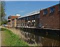 TQ0256 : Industrial units, River Wey navigation by Alan Hunt