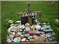 SD4255 : Painted stones and trinkets, Sambo's Grave at Sunderland Point by Karl and Ali