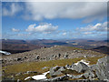 NH4883 : Mountain walker approaching summit of Carn Chuinneag by Trevor Littlewood
