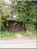 TM4087 : Bus Shelter on Redisham Road by Adrian Cable