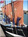 NT6779 : Coastal East Lothian : Four Men In A Boat by Richard West