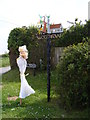 TM2993 : Woodton Village sign & Scarecrow by Adrian Cable
