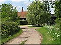 TL8725 : Approaching Baldwin's Farm, Great Tey by Roger Jones