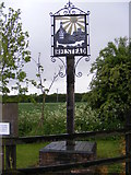 TM1340 : Belstead Village sign by Adrian Cable