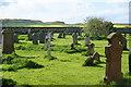 NU1734 : The churchyard of St Aidan's, Bamburgh by Bill Boaden