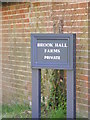 TM3875 : Brook Hall Farms sign by Geographer