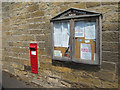 NU1328 : Parish notice board and post box, Warenford by Graham Robson