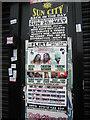 TQ3268 : Posters on shopfronts, Thornton Heath by Christopher Hilton