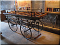NT8947 : Funeral bier in St Cuthbert's church by Stephen Craven
