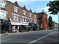 TQ2672 : Shops and church in Garratt Lane, Earlsfield by David Martin