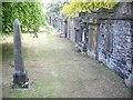 NT2473 : Cemetery wall, St Cuthbert's parish church by Stanley Howe
