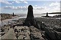 NX5849 : Navigation pillars at Knockbrex Bay by Walter Baxter