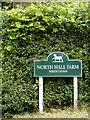 TM4884 : North Hall Farm sign by Adrian Cable