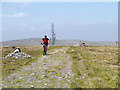 SD9813 : Pennine Way, Cyclist and Two Cairns by David Dixon
