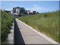 NT2673 : Path between 'tails', Scottish Parliament landscape by Robin Stott