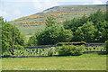 NY5218 : The cemetery at Bampton Grange by Bill Boaden
