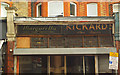 TQ3088 : Old shop signs, Crouch End by Julian Osley