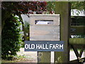 TM3076 : Old Hall Farm sign by Adrian Cable