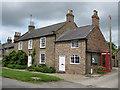 SE7967 : Brick cottage, Langton by Pauline E