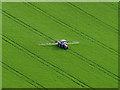 NT1397 : Crop spraying by William Starkey
