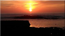 SW3526 : Sunset behind the Cowloe rocks at Sennen Cove by Rod Allday