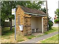 SP6312 : Bus shelter with security gates by Steve Daniels