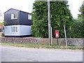 TM3282 : Church Farm & St.Nicholas Postbox by Adrian Cable