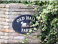 TM3182 : Old Hall Farm sign by Adrian Cable
