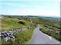 M1101 : Switchback road at Carrownycleary by Oliver Dixon