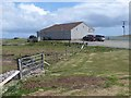 HU5966 : The clubhouse at Whalsay Golf Course by Oliver Dixon